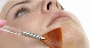 Brush on woman's face
